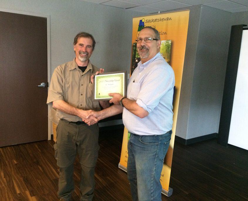 STA President Saul Lipton (right) presents Joe Milligan with the STA Trail Stewardship Award.